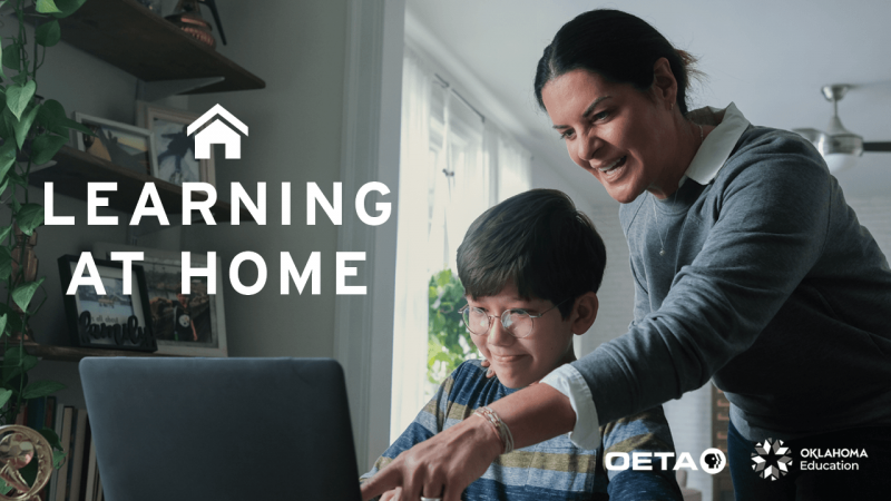 Learning At Home banner - mother looking over sons shoulder pointing at computer