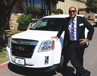 Oklahoma Teacher of the Year with the Teacher of the Year car
