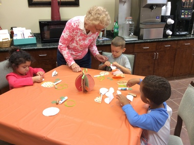 nursing home members interact with pre-K students