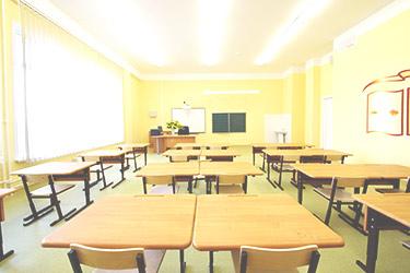 empty, bright yellow classroom