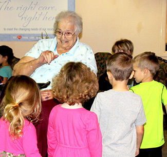 nursing home residents meet with schoolchildren