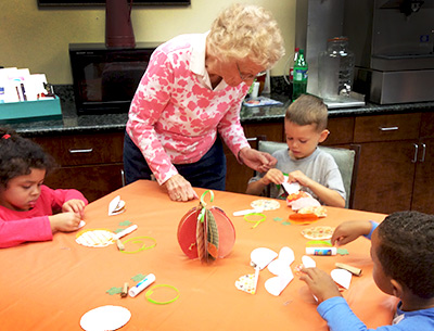 Nursing home residents working with children