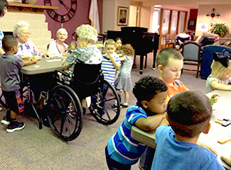 schoolchildren mingle with nursing home residents