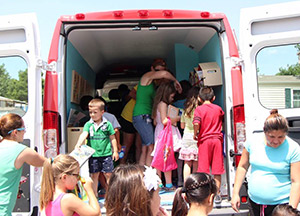Mobile book van with parents and kids