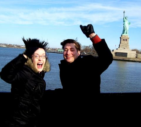 Peter Markes and work colleague Angela Allen in front of the Statue of Liberty