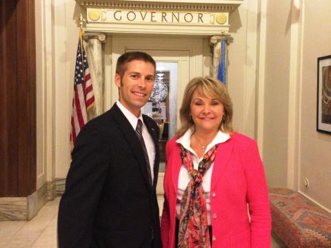 OKTOY Jason Proctor and Governor Mary Fallin in the State Capitol.