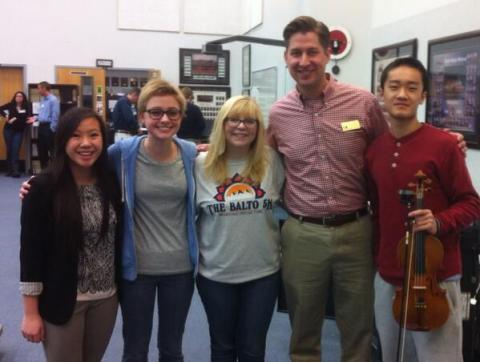 OKTOY Peter Markes poses with students.