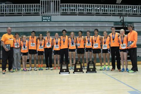 Jason Proctor and his distance running team pose with state runner up trophies