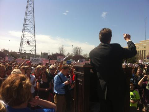 A speaker on the steps of the Oklahoma State Capitol at the March 31 teacher rally.